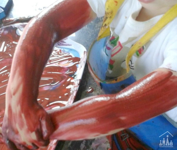 Child's arms covered in paint