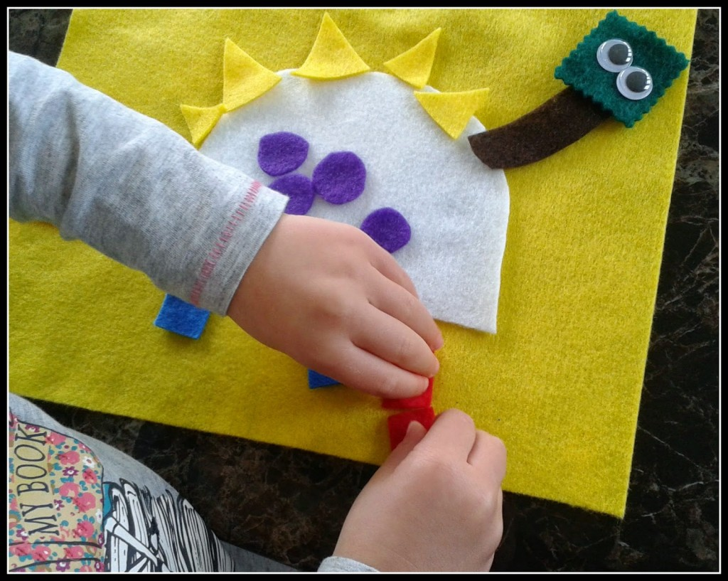 making a dinosaur shape collage with felt