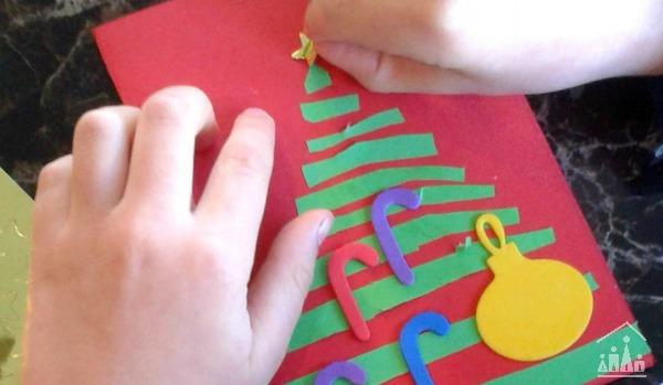 Sticking a star on top of a Christmas Tree Card