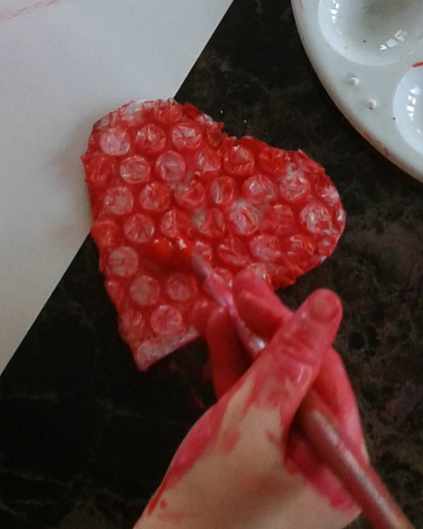 painting a bubble wrap heart to go onto a valentines day card