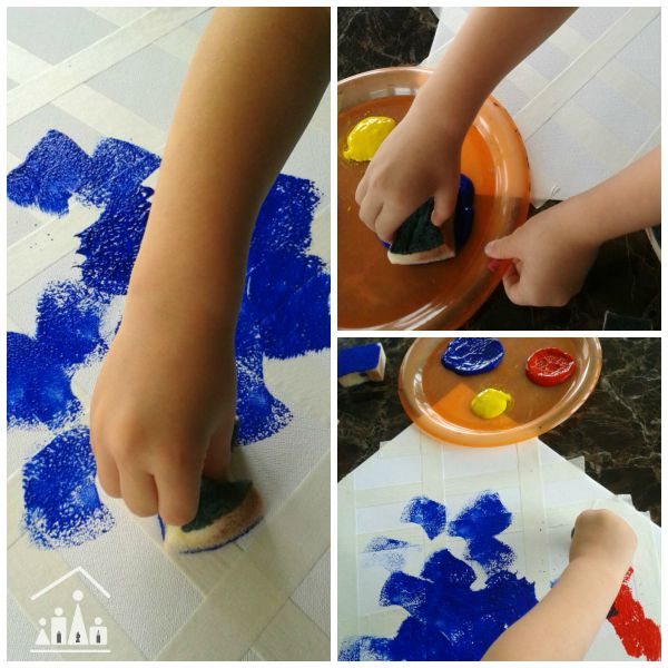 doing tape resisit sponge painting for preschoolers