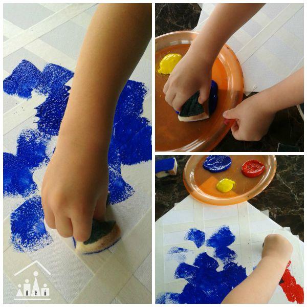 doing tape resisit sponge painting for preschoolers