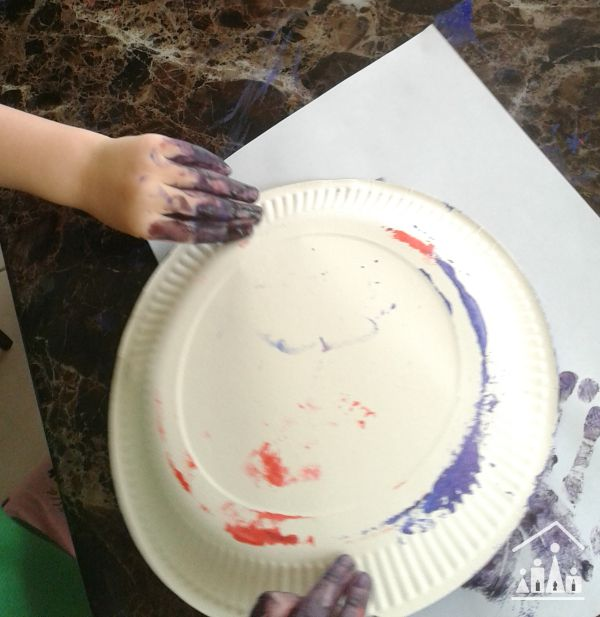 tape resist sponge painting for preschoolers getting messy