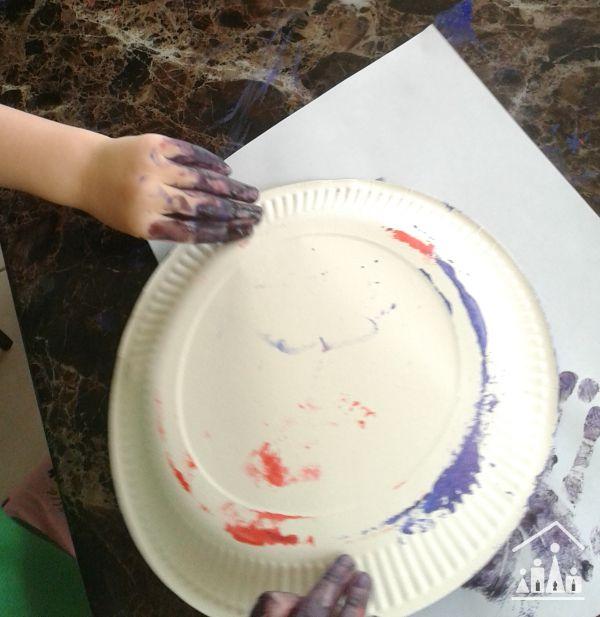 tape resist sponge painting for preschoolers getting messy