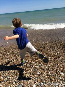 Outdoor Activities for Kids Throwing Rocks on the Beach