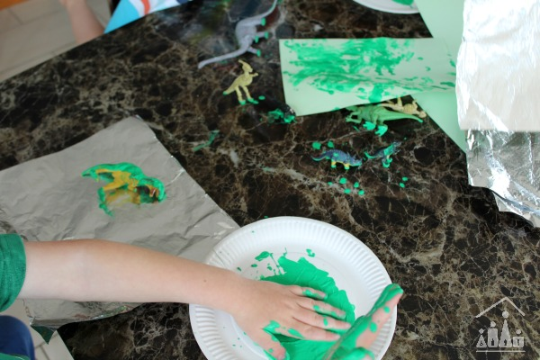 Dinosaur Painting on Foil Action Shot