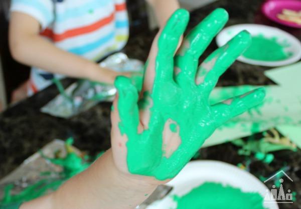 Dinosaur Stomp painting messy green hands