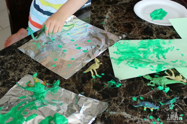 Dinosaur Painting on Foil Action Shot