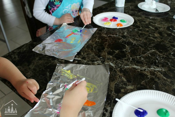 Kids doing tin foil painting