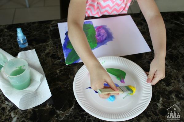 Preschooler Painting on Paper