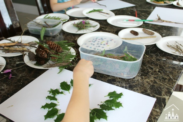 Kids making nature collages inside