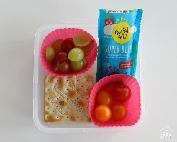 Healthy school lunch with crackers grapes and tomatoes
