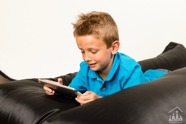 Child reading on a beanbag