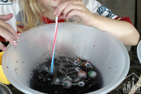 blowing bubbles into a Halloween Potion