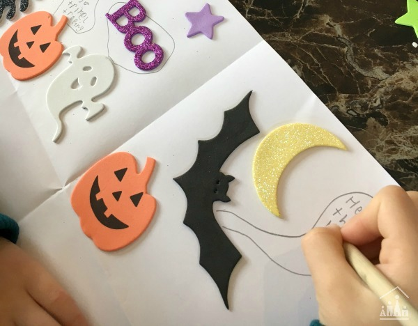 Writing a spooky story using sticker prompts