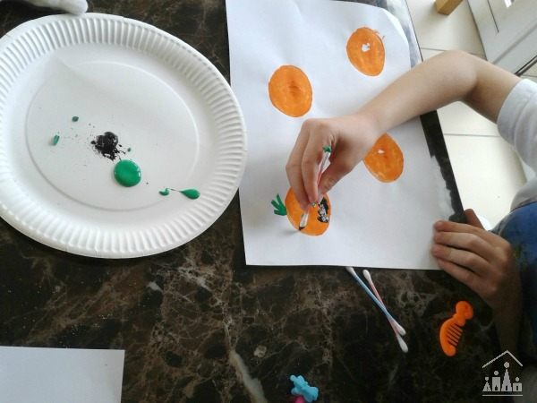 Decorating potato print pumpkins