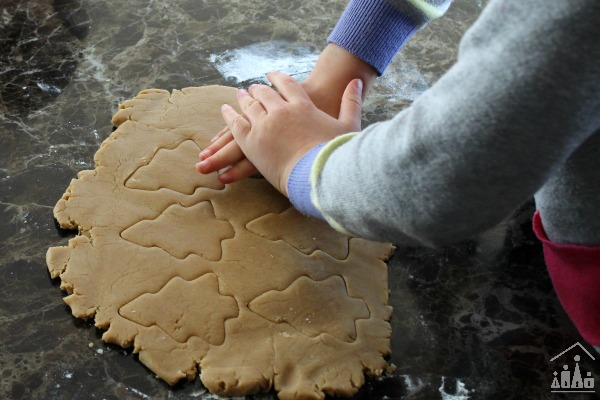 Cutting out Christmas Tree Cookies