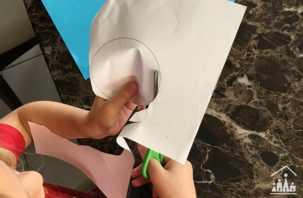 Child cutting out a circle