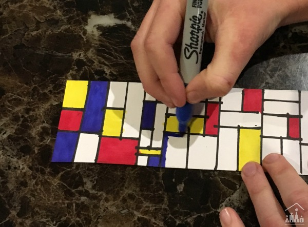 Child making a bookmark in the style of famous artist Piet Mondrian