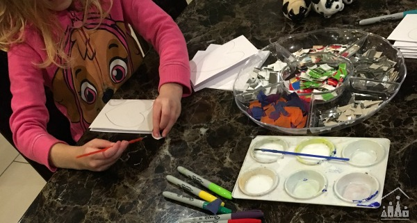 Child making a thank you card