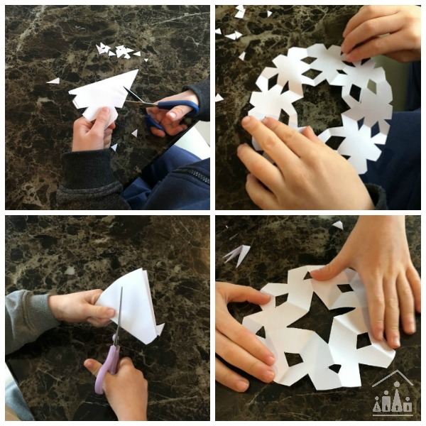 Kids cutting out snowflakes