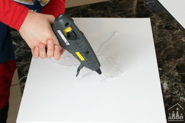 Child using a hot glue gun