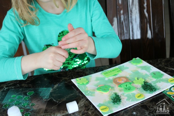 Adding glitter to a St Patrick's Day Collage
